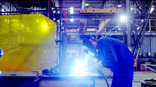 male engineer using welding torch 4k - saldare video stock e b–roll