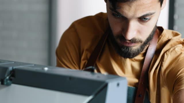 Male Fashion Designer Working in His Studio