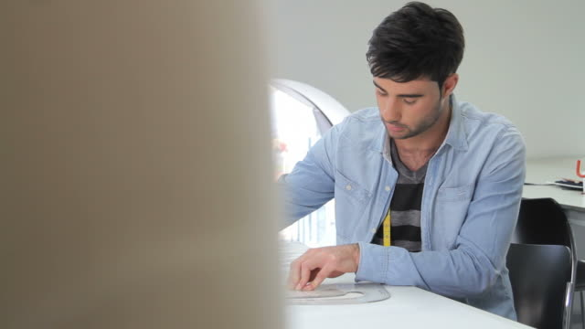 Male Fashion Designer working in studio video