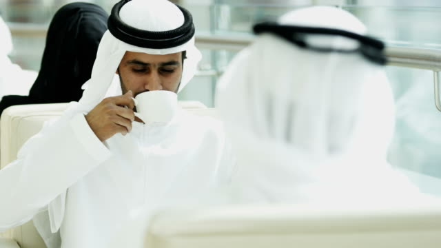 Male female Emirati people national dress drinking coffee video