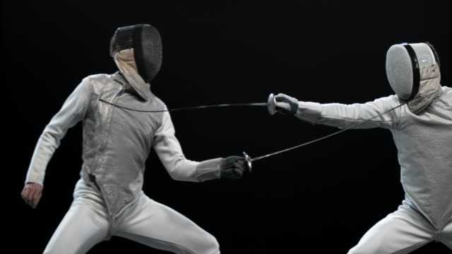 Video SLO MO PAN Male fencer striking the opponent and winning a point