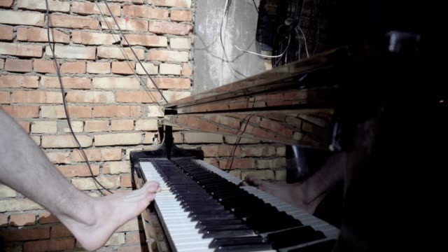 Male foot playing a gentle piece on a beautiful grand piano. video