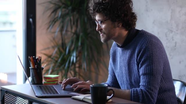 Male freelancer working at laptop