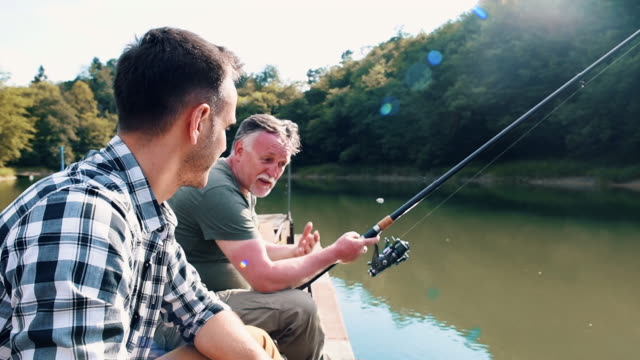 male friends fishing together while camping - fishing video stock e b–roll