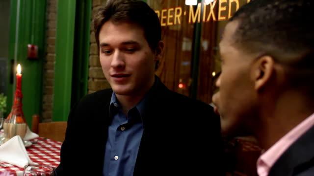Male Friends Talk in Restaurant video