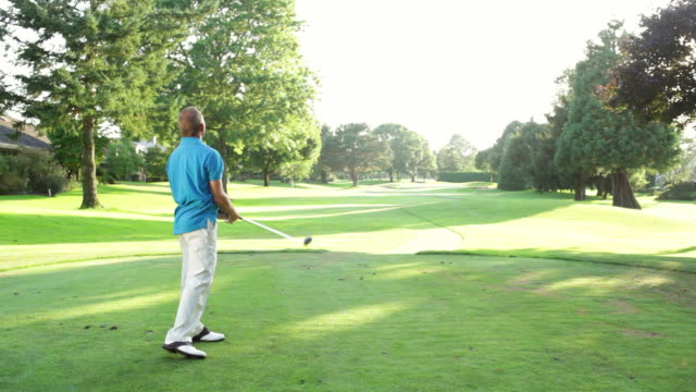 Male golfer tees off. video