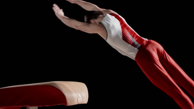 SLO MO Male gymnast doing his routine on the vault video