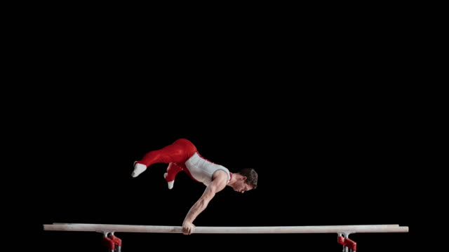 ld male gymnast in an l-sit and hand stand position - gymnastics stock videos and b-roll footage