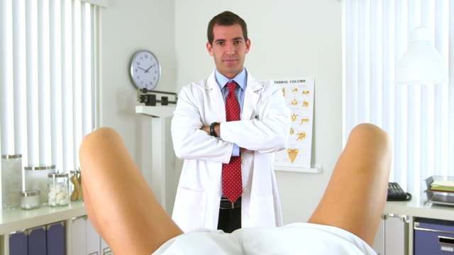 Male gynecologist standing in front of woman video