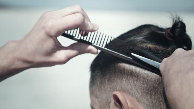 Male haircut outdoors. Man hairstyle. Stylish haircut. Hipster haircut video