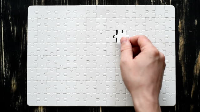 male hand adds white puzzle video