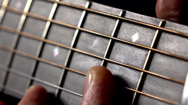 Male hand and strings on fretboard. Music performance. FullHD macro video video