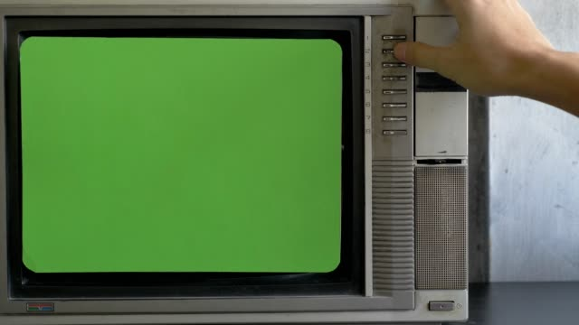 Male hand changing channels on the retro old TV with green screen display Male hand changing channels on the retro old TV with green screen display hd format stock videos & royalty-free footage