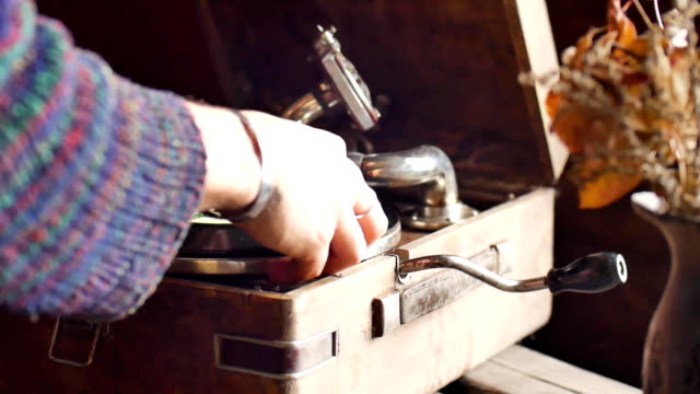 Male hand clean gramophone needle in slow motion video