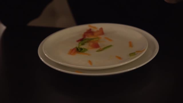 A male hand collects leftover food from a plate with a fork. Leftovers of vegetable salad on a plate. A male hand collects leftover food from a plate with a fork. Leftovers of vegetable salad on a plate leftovers stock videos & royalty-free footage