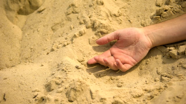 Male hand falling lifeless on sand, death of thirst in sahara, lack of water Male hand falling lifeless on sand, death of thirst in sahara, lack of water thirsty stock videos & royalty-free footage