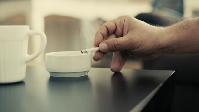 man hand som håller en cigarett - coffe with death bildbanksvideor och videomaterial från bakom kulisserna