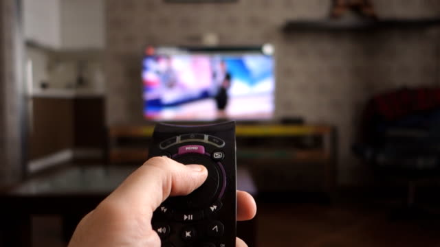 male hand holding the tv remote control and turn off smart tv. channel surfing - television industry stock videos & royalty-free footage