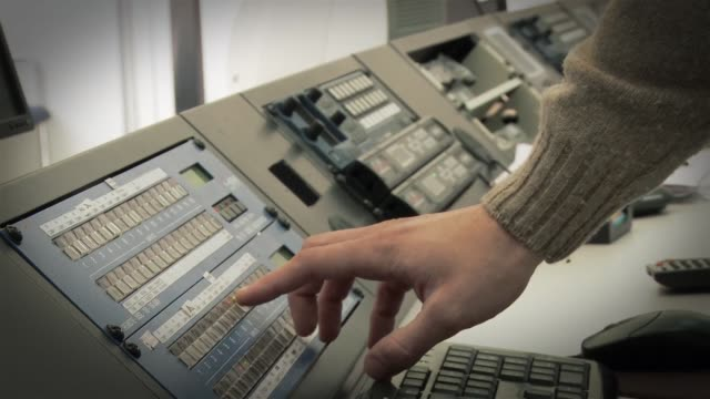 Male Hand on Console at a Satellite Terrestrial Television Station.