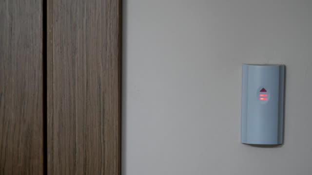 male hand open security door with Finger scanner video