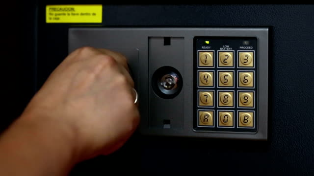 male hand pushing security code and taking out money and passports from safety box - safes and vaults stock videos & royalty-free footage