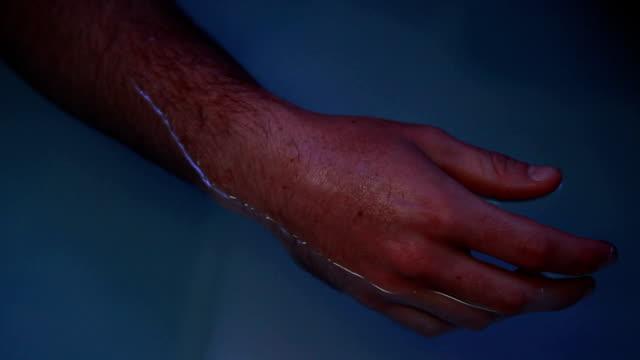 male hand sensory deprivation tank video