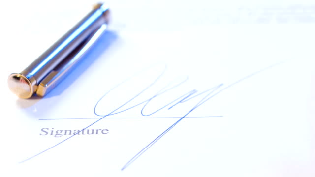 Male hand signing document video