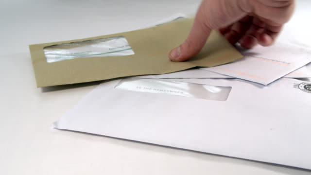Male hand sorting household finances Adult male goes through a pile of household bills and pics one out to pay post structure stock videos & royalty-free footage