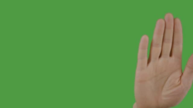 male hand swiping screen on green background. alpha channel, keyed green screen - palm of hand stock videos & royalty-free footage