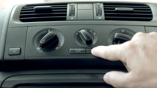 Male hand turning switch of car air conditioner video