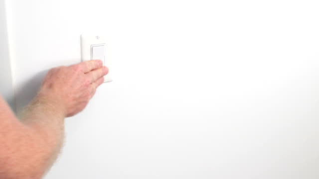 Male Hand with Forearm Pressing Light Switch On and Off video