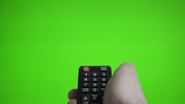 Male hand with remote control turns on the TV over green screen. Place for your advertisement. Male hand with remote control turns on the TV over green screen. Place for your advertisement. multimedia stock videos & royalty-free footage