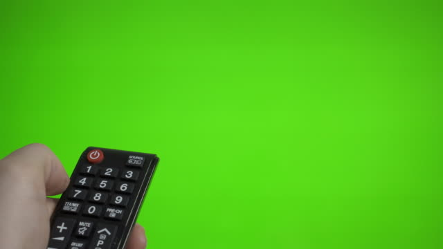 Male hand with remote control turns on the TV over green screen. Place for your advertisement. Male hand with remote control turns on the TV over green screen. Place for your advertisement. changing channels stock videos & royalty-free footage