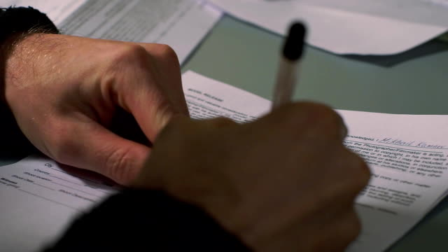 A male hand writing video