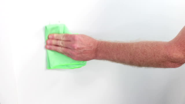Male Hands Cleaning a Light Switch with a Green Cloth video