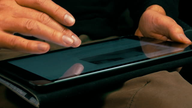 Male Hands Scrolling on a Tablet Computer, closeup video