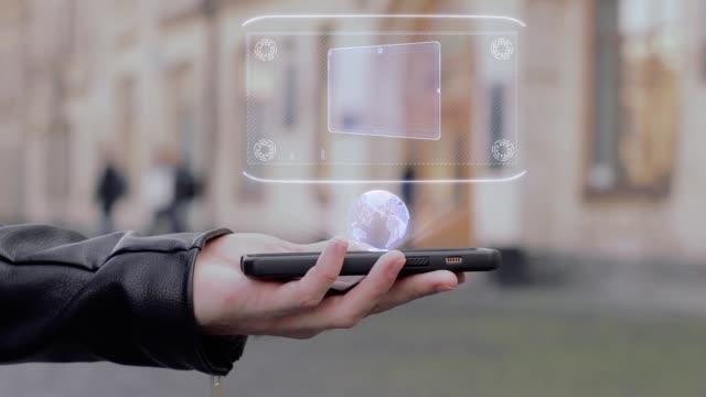 Male hands show HUD hologram tablet