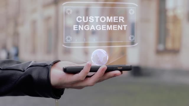male hands show on smartphone conceptual hud hologram customer engagement - fedeltà video stock e b–roll