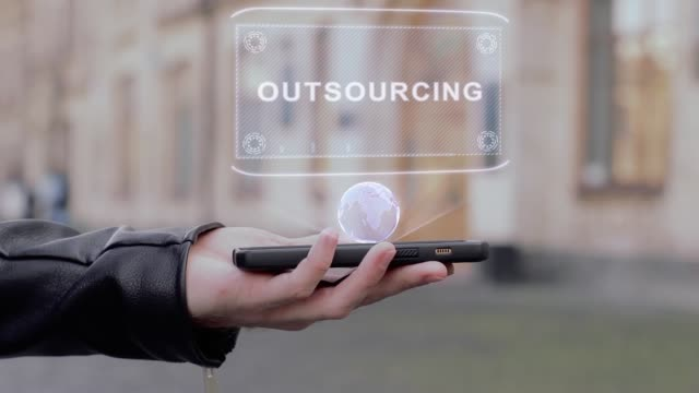 Male hands show on smartphone conceptual HUD hologram Outsourcing