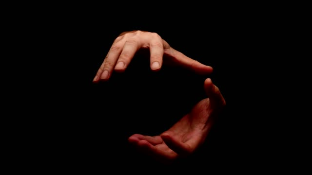 Male hands showing gesture isolated on black background video