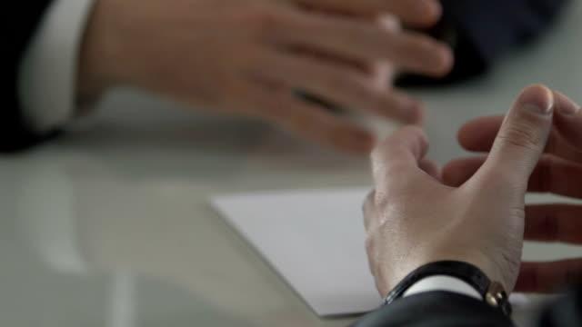 vídeos de stock e filmes b-roll de male hands taking dollar cash envelope from business partner, credit payment - corruption