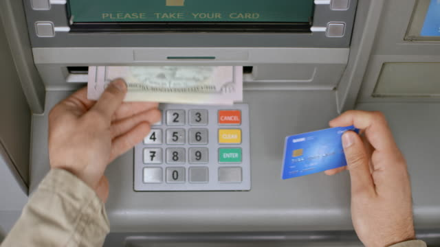 ds male hands taking out the bank card out of atm and counting the money - banks and atms stock videos & royalty-free footage
