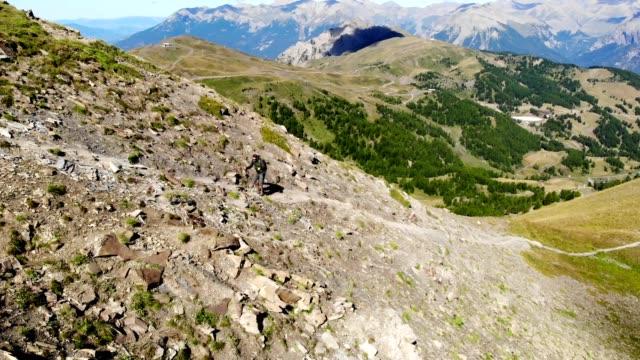 male hiker walking on rocky mountain against blue sky video 4k - hautes alpes stock videos & royalty-free footage
