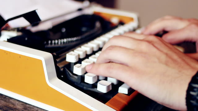 Male human hands writing with an old 80 s style typewriter Male human hands writing with an old 80 s style typewriter typewriter stock videos & royalty-free footage