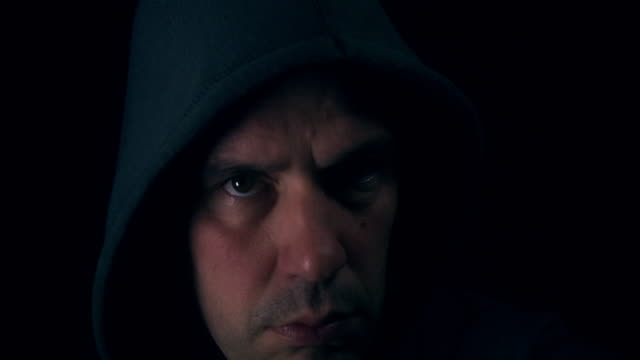 Male in hoodie looking angrily at the camera video
