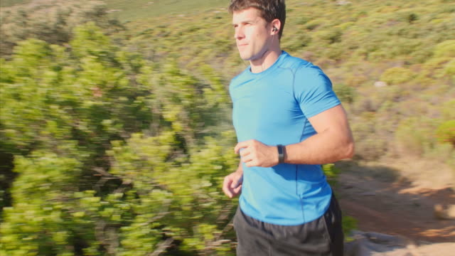 Male jogger checking time on his sports watch before run video