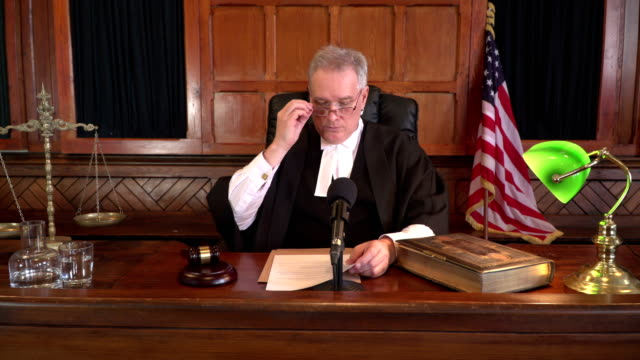 4K DOLLY: USA Male Judge in Court listening to case video