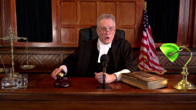 4K DOLLY: USA Male Judge in Courtroom using Gavel video
