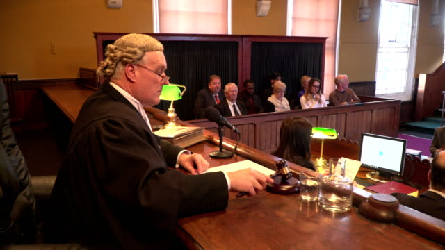 4K DOLLY: Male Judge in Courtroom with Jury video