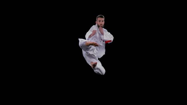 SLO MO LD Male karateka performing the flying kick